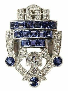 An Art Deco sapphire & diamond clip brooch, Cartier, ca the openwork shield highlighting an Old Mine cut diamond, weighing approx cts; embellished with Old European cut diamonds, round mixed & square step cut blue sapphires; Bijoux Art Deco, Art Nouveau Jewelry, Jewelry Art, Antique Jewelry, Jewelry Accessories, Vintage Jewelry, Fine Jewelry, Fashion Jewelry, Jewelry Design