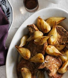 Hearty pork chops and gravy take an elegant turn with the addition of luscious Bosc pears and fresh rosemary. Be sure to peel pears before cooking—the skin toughens when heated. Recipe: Pan-Seared Pork Chops with Rosemary and Pears   - CountryLiving.com