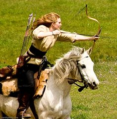 Lady archer - not a longbow, but note the cut on her blouse, and the quiver style on a simple weapons belt w/ waist cincher.