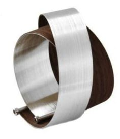 This is a beautiful modern wraparound bangle, which consists of contrasting strips of lightweight steel and wood veneer. The steel tubing at the end of each strip is set with a sparkling crystal to add a touch of understated glamour to this architectural piece.  A striking and contemporary jewellery collection.  Designer: Radek Szwed