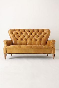 I LOVE this sofa from Anthropologie. It would be perfect in J's home studio! Hmm...