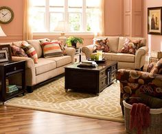 Morgan Living Room Collection        Morgan's honey colored chenille and brightly colored accent pillows are the perfect place to start for transitional space. Roll arms are typically seen on traditional sofas, but the pillows' patterns are more contemporary. A neutral area rug and pale wall color let the furniture act as the star of this room.