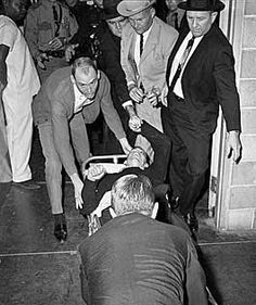 11/24/63 - Mortally wounded, Lee Harvey Oswald is wheeled into Parkland Hospital.
