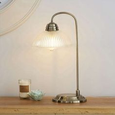 Crafted with an antique brass effect, this vintage-style table lamp features a tall brass base and a ribbed glass shade. Table Lamp Shades, Brass Table Lamps, Bedside Table Lamps, Desk Lamp, Glass Shades, Antique Brass, Cleaning Wipes, Chrome, Vintage Fashion