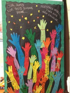 Aim High ~ Have students trace their arms on colored paper, and fill your door with student goals for the school year. Save these goals for reflection in June.