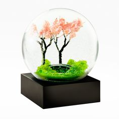 """""""The end of spring lingers in the cherry blossoms"""" - Buson A celebration of National Poetry Month, from the haiku at the base of the Spring Snow Globe"""