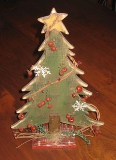 Wood Christmas Tree - my dad carved out some trees like this, I plan on finishing one like this