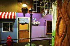 """Children's """"Main Street"""" themed environment for church center. www.ImaginationAtmospheres.com"""