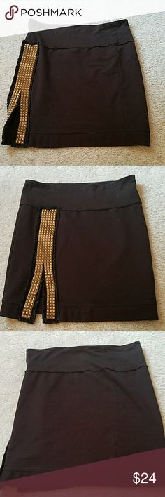 Studded Black bodycon Funky and edgy black bodycon skirt with stitching details on top band, side, and bottom. And of course the awesome studs lined with fringy fabric. I like you can wear it with studs in front or on side! Size S but fits me, a L so size is versatile. Perfect condition. We The Free by Free People. Might have to keep this gem if it doesn't sell so snap it up ?? Free People Skirts