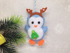 A personal favorite from my Etsy shop https://www.etsy.com/listing/567356281/felt-penguin-ornament-blue-christmas
