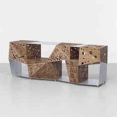 five cubes, drilled with perforations, make up the storage unit Riddle Cabinet. The piece, which is reminiscent of Holl's Sliced Porosity Block in China, was designed for furniture maker Horm Srl, and is from the first year of its production, 2006.