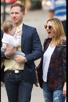 I absolutely love the happy look on Drew Barrymore's daughter face.