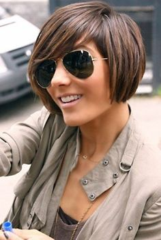 sassy bob cut with a deep side bang! perfect style for someone whose active yet will allow a classy look when styled with the deep bang!