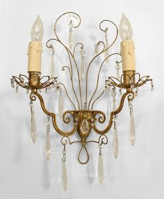 This chandelier sports an antiqued finish and elegantly curvaceous ...