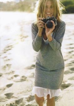 Aniston. Wish I looked this good sporting my camera. Have always loved her style!