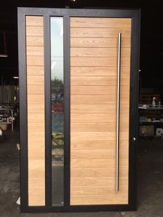 This is a custom Statement door with a pull bar Modern Entry Door, Modern Wooden Doors, Contemporary Front Doors, Entry Doors, Main Entrance Door Design, Front Door Design, Front Door Landscaping, Porte Design, Balustrades
