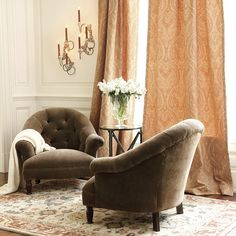 The Julia Chair's pleated arms, tufted back, and gracefully sloped shoulders embrace you. Like most antique upholstered chairs, this chair has a low seat.