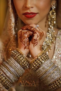 "the most glamorous brides of brides the ""Indian bride"" the gold jewellery,mehndi,bangles,the shimmery make up,indian ethnic wear ,nathni completes and indian bride."