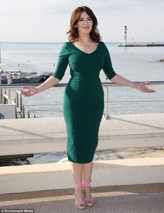 Gorgeous in green: Nigella stuck to her tried-and-tested demure yet sexy look as she sported the fitted teal gown, which was cut just below the knee