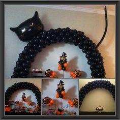 Halloween inspired balloon decorations. Black cat arch & balloon table arch. Black & orange balloon center pieces w/ witch balloon. #balloonsville Www.balloonsville.com