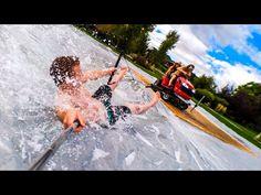 Watch: Lawnmower Slip N Slide - The Awesomer