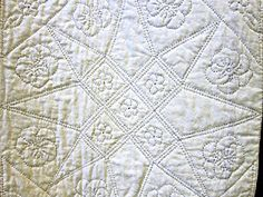 Hand quilting, black thread on white fabric, seen at 2012 quilt show