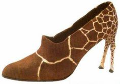 giraffe shoeshad these, my life would be complete... its my two favorite things on earth: shoes and giraffes... now only if they were green hah