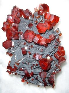 Vanadinite: First discovered in 1801 in Mexico. Vanadinite is an uncommon mineral, only occurring as the result of chemical alterations to a pre-existing material. Natural Crystals, Stones And Crystals, Gem Stones, Natural Gemstones, Minerals And Gemstones, Rocks And Minerals, Dame Nature, Crystal Magic, Beautiful Rocks