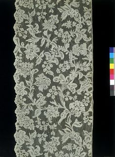 V&A;  Flounce        Place of origin:        France (possibly, made)      Brussels (city) (possibly, made)      Date:        about 1750 (made)      Artist/Maker:        Unknown (production)      Materials and Techniques:        Needle lace      Credit Line:        Given from the collection of Mary Viscountess Harcourt CBE      Museum number:        T.22-1965        This fine, deep lace flounce may have been intended for a dress, but was probably used to decorate a bed or dressing-table. Such extravagant use of lace could only be afforded by royalty or the very wealthy, who might expect to receive visitors in their bedrooms or dressing rooms. Queen Charlotte, wife of King George III, paid more than  1000 English pounds for lace to cover her dressing table in 1764, an enormous sum of money at that time.  Evidence from paintings and inventories suggests that such lace would be lined with silk of a rich contrasting colour, often pink or crimson, enhancing the effect of the pattern. The design here of meandering exotic flowers reflects closely the types of pattern seen in the silks and embroideries used for fashionable clothing in this period.