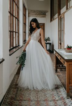 a24e714a2c8 Boho style off-white lace and tulle scalloped V-neck and V back A-line long  wedding dress. In addition to the beautiful back neckline
