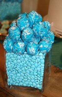 Ready to pop! centerpieces? or on the food table?  Cute baby shower decor idea!