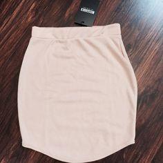 New missguided tan skirt Mini tan Nwt. Sz US4, no trades. Missguided Skirts Mini
