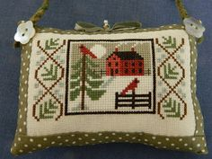Winter house cross stitch   (....cr.... this is taken from a part of Prairie Schooler's Winter Wind leaflet....the side borders are on the chart, too....pretty ornament)