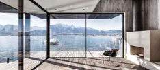 """Beautiful house situated between the banks of Lake Thun that offers panoramic views of the lake and mountains Architects:Marazzi+Paul Architecture ltd Location:Hilterfingen, Switzerland Year: 2016 Photo courtesy:Marazzi+Paul Architecture ltd Description: """"The boathouse is situated between the banks of Lake Thun and a busy street. Inspired by the architecture of the surrounding buildings, a new interpretation …"""
