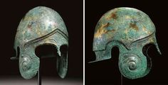 Chalcidian helmet, archaic period, late 6th century B.C. Of hammered sheet, with a small nose-guard, broadly curving cheek-pieces, sharply carinated perimeter and everted flange along the neck-guard, with a molded spiral motif on each cheek-piece, ridges around the eyes, high arching brows above, the perimeter peaked at the center, with elaborate egg-and-dart molding below the ridge, a palmette at the center and along each temple, 27 cm high Private collection, from Christie's auction