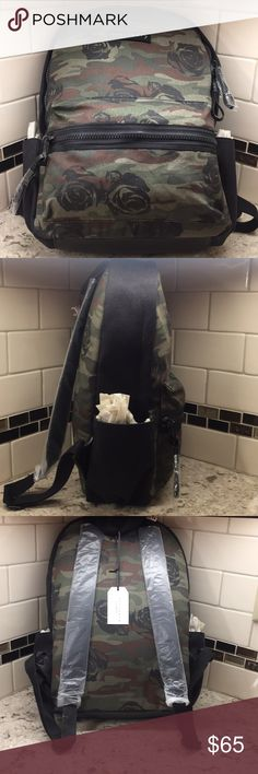 FINAL HOURS!!!!!!Sanctuary Downtown backpack New with tags Rose/camo print canvas and black suede trim backpack. Double back strap and top handle large front zip pocket and 2 side pockets.  Inside is fully nylon lined with added attaché zippwr pouch and pockets on inside back and front Sanctuary Bags Backpacks