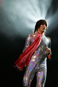 Mirrorball suit with a flowing red scarf