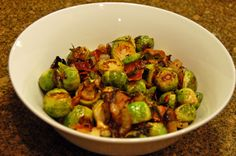 roasted brussels sprouts with bacon and caramelized onions - a sure crowd pleaser! via musings of a housewife