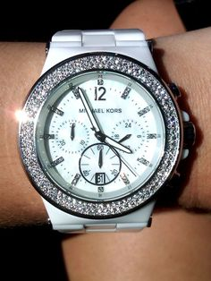 Best present to receive would be a Michael Kors Watch <3