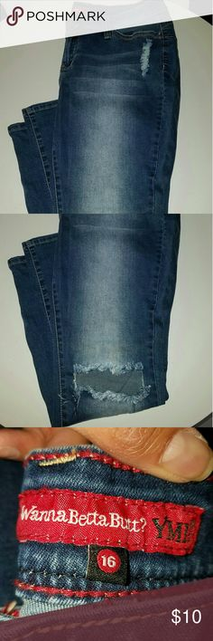 Distressed jeans Blue jeans, torn at the knees. Very cute! YMI Jeans Skinny