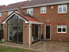 Too framey / blocky / grid like Conservatory Dining Room, Modern Conservatory, Conservatory Design, Conservatory With Tiled Roof, Bungalow Extensions, Garden Room Extensions, House Extensions, Kitchen Extensions, House Extension Design