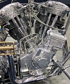 Engraved knucklehead engine with magneto and rigid stainless oil lines by Chemical Candy Customs