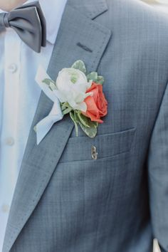 Boutonniere with a pretty pop of coral! Photography by Forevercandid Photography / forevercandid.com