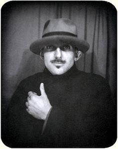 Ansel Adams self portrait taken in a photo booth during the 1930's