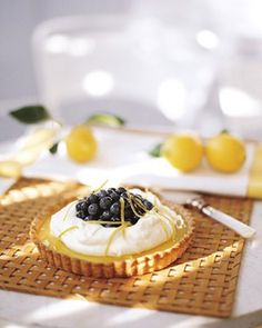 Lemon-blueberry tart, filled with a tangy lemon curd, is topped with whipped creme fraiche and a garnish of candied lemon zest.     Martha Stewart