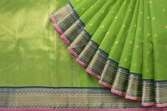Majestic peacock motif adorns this Organza silk sari in green and blue.