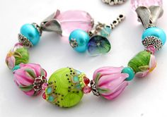 I adore these sweet Spring colors and flowers, along with the romantic Bollywood style feel!  Featuring gorgeous lampwork beads by Amy