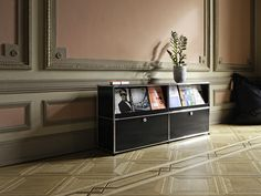 USM Haller credenza, metal angles lift up for additional storage space behind.