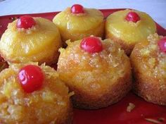 1  Yellow  Mix with pud in mix 1 3.4 o Vanilla Int Pud 3 eggs 1/3 c oil 2/3 c pine juice 1/3 c milk 1 can pineapple slices, drained (save juice) or- 1  can crushed pine, drained        1 stick butter 1 c br sugar mar cherrie  Spray muffin tins  with spray. Melt butter and sugar on stove. Add 1 T sugar mix to each  cup.  put in 1 T crushed,  pin or 1 pin slice in bottom and cherry  mix cake mix, pudding mix, eggs, oil, juice and milk with mixer. Fill c 1/2 with cake mix.  350  for 25 m cool…