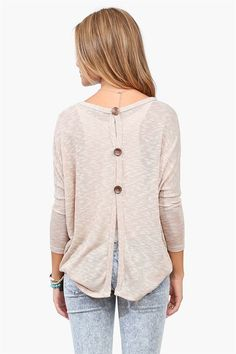 An adorable Taupe, comfy, loose knit sweater with split back and 3 wooden buttons for a dramatic effect. Pair with loose tank and jeans.